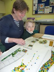 Leckhampton_Teaching_Assistant_helping_with_stained_glass_project.jpg